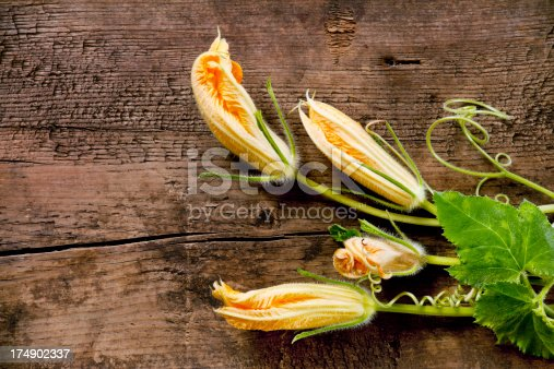 Zucchini flowers on wooden table