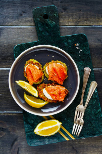 Zucchini fritters with salmon stock photo