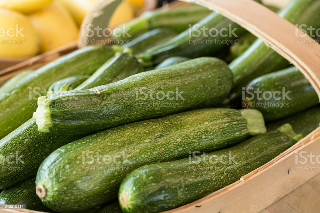 Zucchini In A Basket For Sale At Farmers Market stock photo
