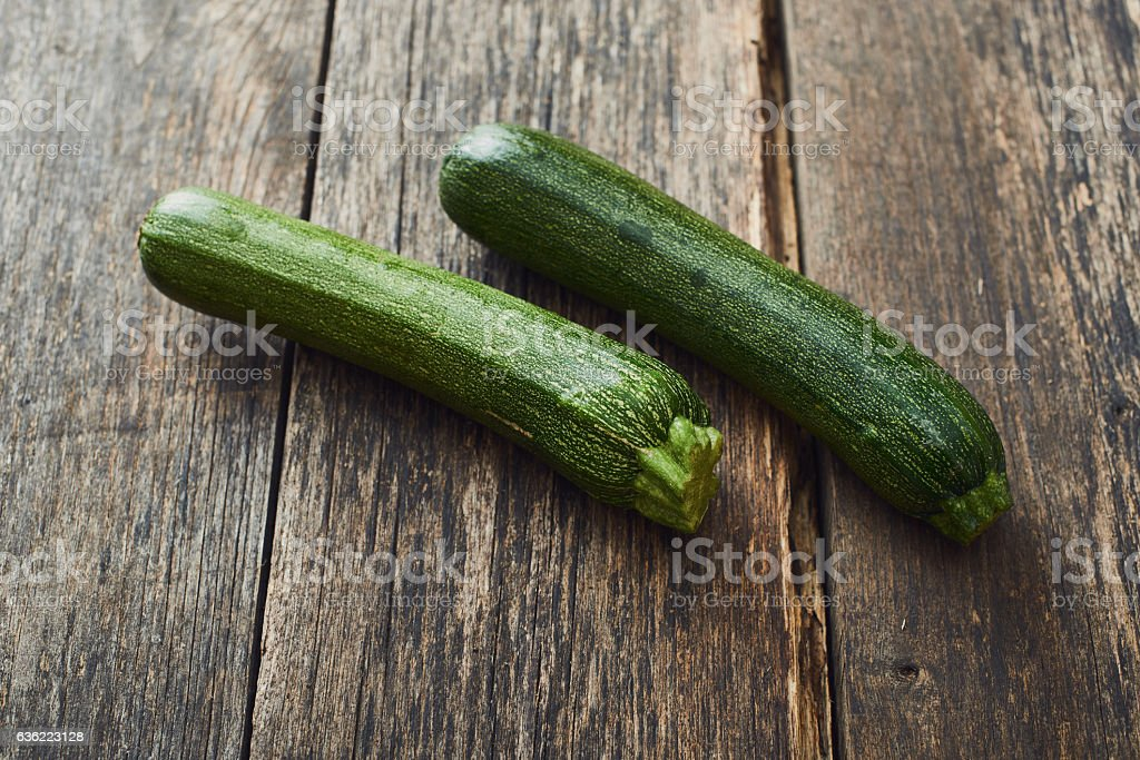 Zucchini on old wooden table stock photo