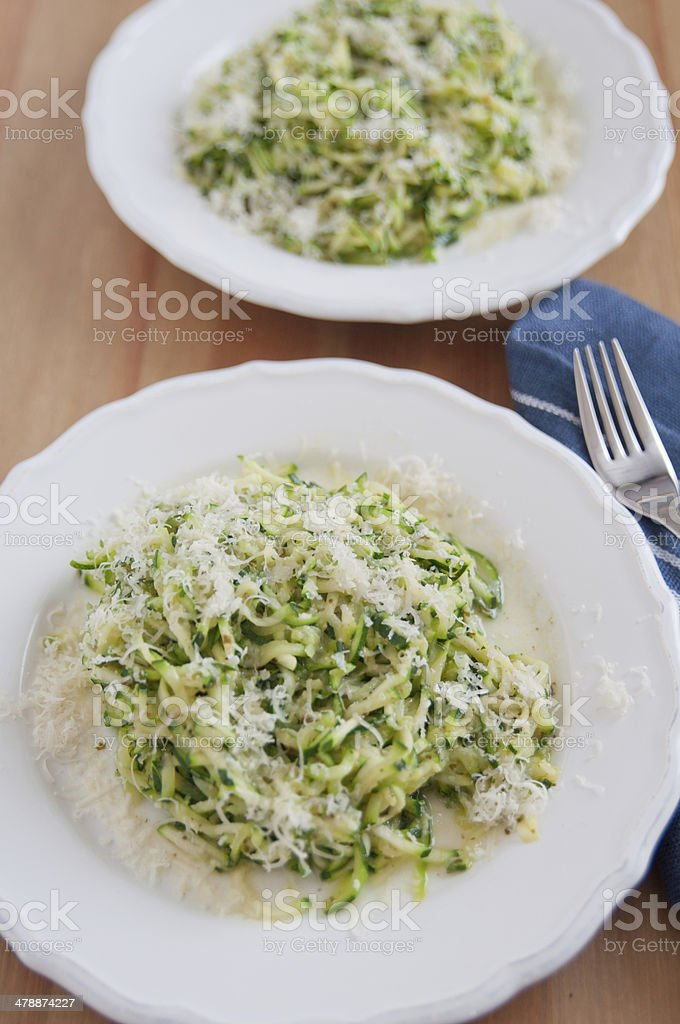 Zucchini Pasta Noodles with pesto stock photo