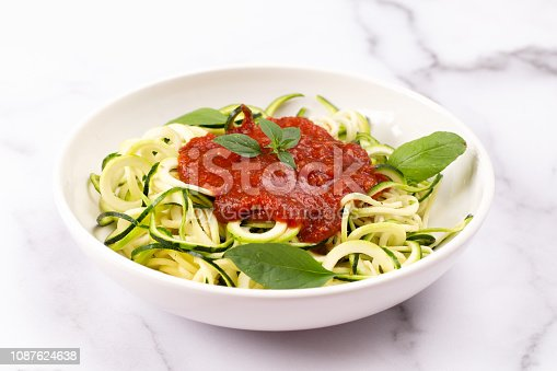 Zucchini Pasta Topped with Tomato Sauce and Basil