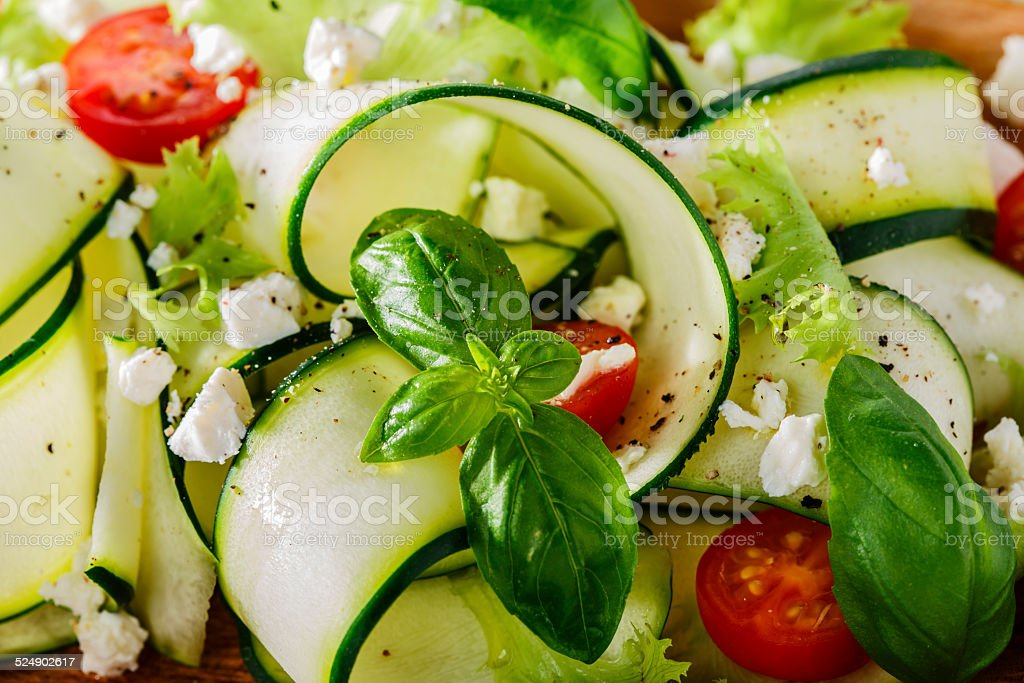 Zucchini salad with tomatoes and cheese stock photo