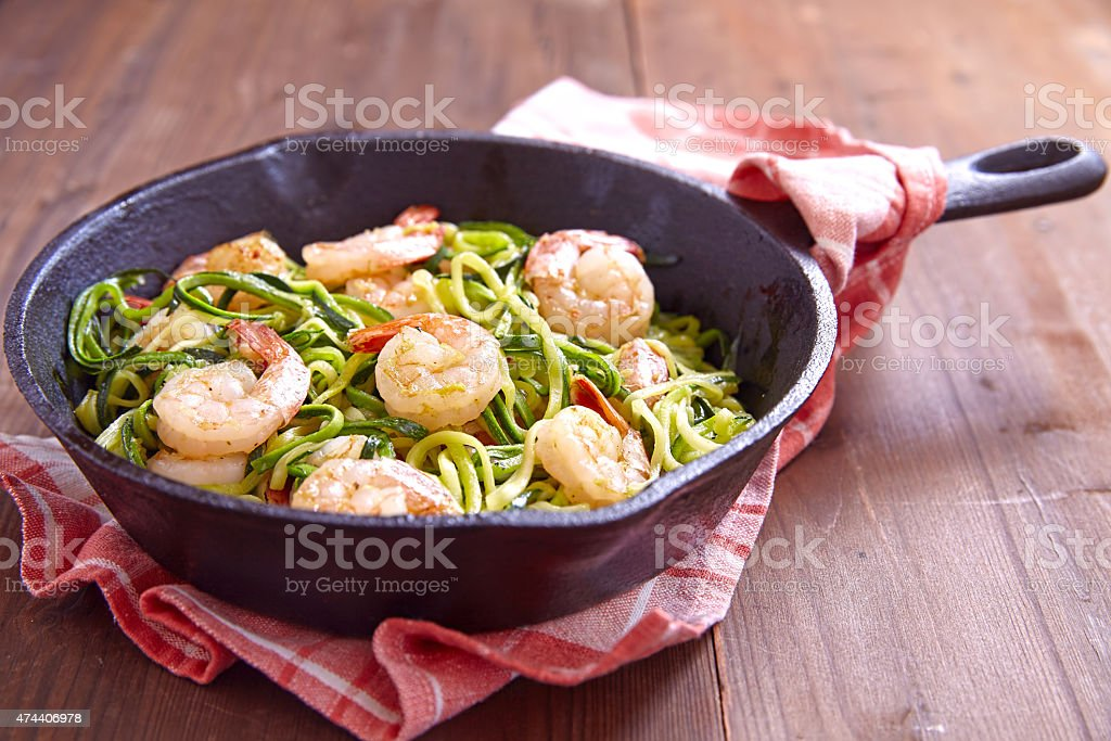 Zucchini spaghetti with shrimp stock photo