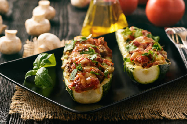 Zucchini stuffed with minced meat, cheese and mushroom. Baked in oven. stock photo
