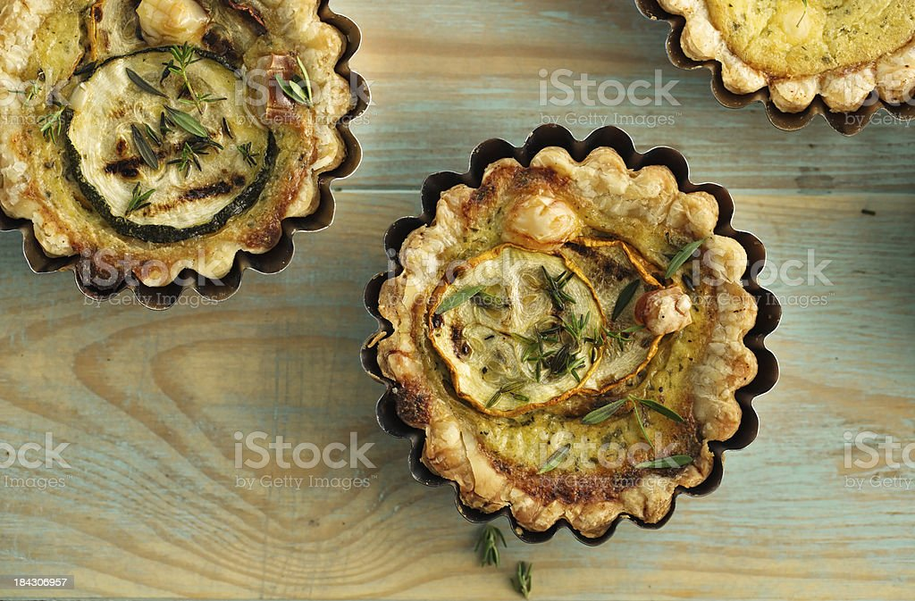 Zucchini tart with and herbs stock photo