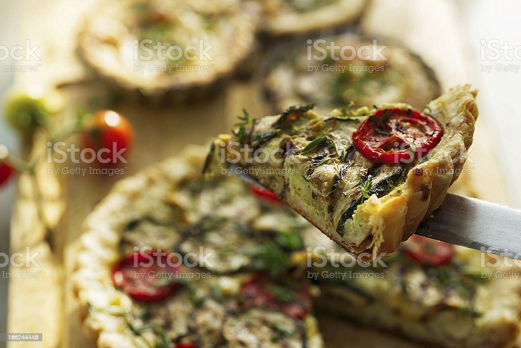 Zucchini tart with tomato and herbs stock photo
