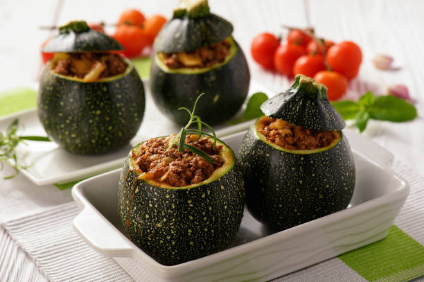 Zucchinies stuffed with meat and vegetables. stock photo