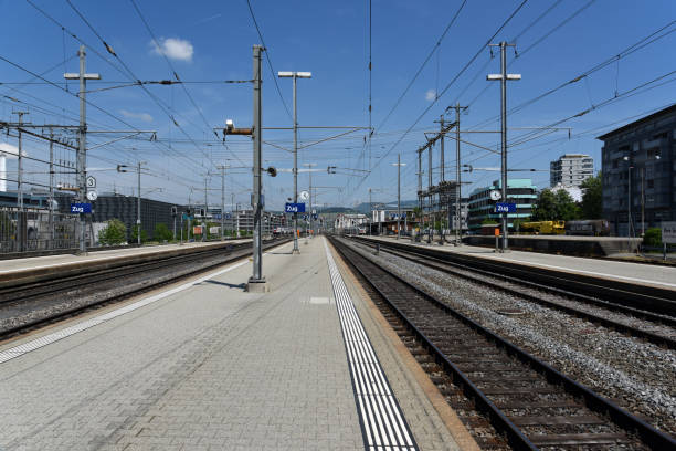 Zug railroad station platform Zug city with railroad station platforms at the railwy station. Zug is a small but growing city a bit outside of zurich. zug stock pictures, royalty-free photos & images