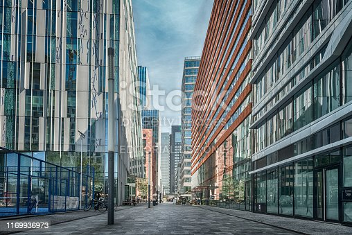 Amsterdam, Claude Debussylaan, the Netherlands, 08/23/2019, Street in the Amsterdam Zuidas (South axis) business district, modern office buildings, Sky scrapers, bars, cafe, shopping