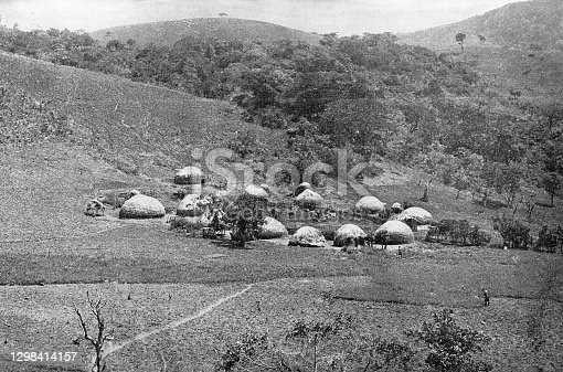 Zulu kraal (village) in the Kingdom of Zululand, South Africa. Vintage photo etching circa 19th century. It was absorbed into the British Colony of Natal in 1897, and then the Union of South Africa in 1910.