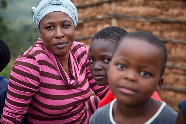 Zulu Woman And Children In Rural South Africa stock photo