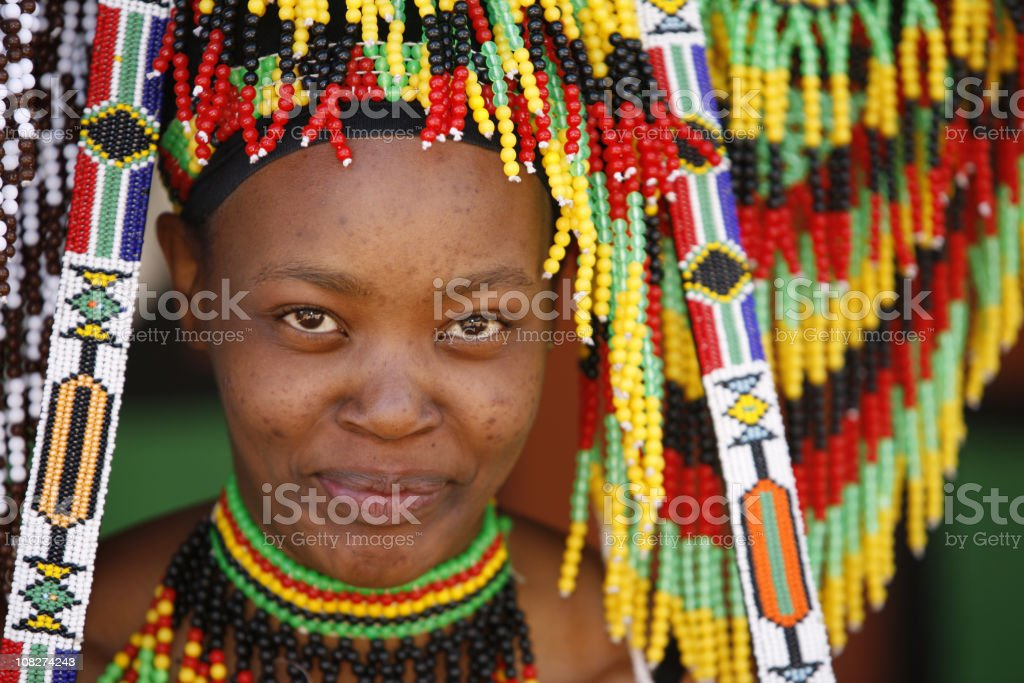 Zulu woman and her souvenirs stock photo