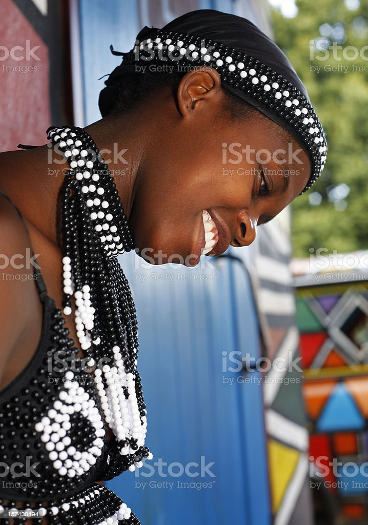 Zulu woman looking down stock photo