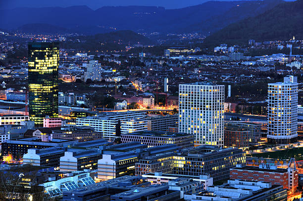 Zurich at night Zurich at night photographed from the Waid, Switzerland zurich stock pictures, royalty-free photos & images