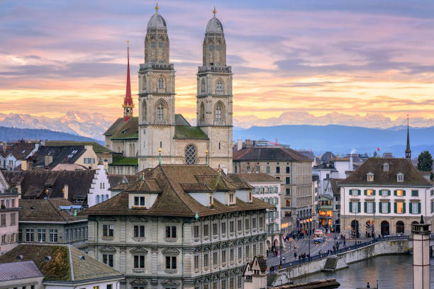 Zurich city center with snow covered Alps mountains in background, Switzerland Zurich city center and cathedral towers with snow covered Alps mountains in background on sunset, Switzerland zurich stock pictures, royalty-free photos & images