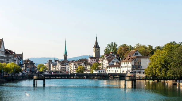 Zurich cityscape and Limmat River in Switzerland Zurich cityscape and Limmat River in Switzerland. fraumunster stock pictures, royalty-free photos & images