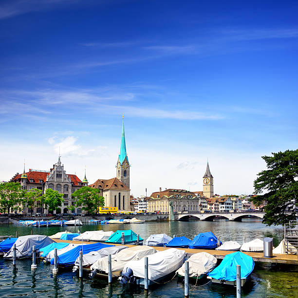 Zurich cityscape Munsterbrucke bridge over the effluence of the Limmat river in the municipality of Zurich. Composite photo fraumunster stock pictures, royalty-free photos & images