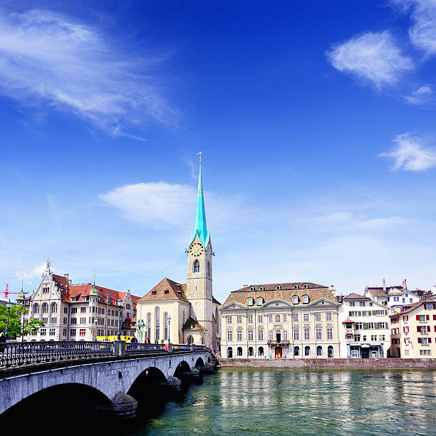 Zurich cityscape Munsterbrucke bridge over the effluence of the Limmat river in the municipality of Zurich. Composite photo limmat river stock pictures, royalty-free photos & images