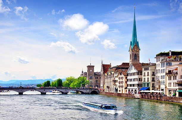 Zurich cityscape Quaibrucke bridge over the effluence of the Limmat river of Zurichsee in the municipality of Zurich fraumunster stock pictures, royalty-free photos & images