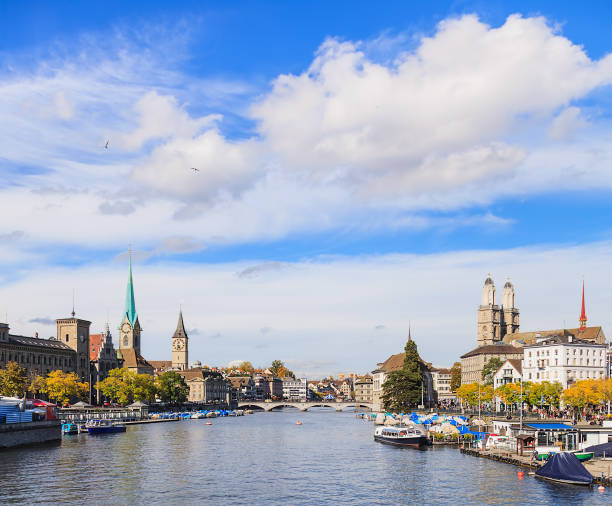 Zurich cityscape View along the Limmat river in the city of Zurich, Switzerland. fraumunster stock pictures, royalty-free photos & images