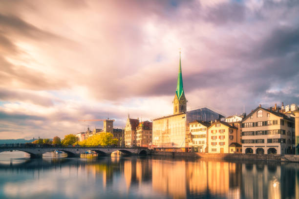 Zurich Fraumunster Church in the morning View over the Limmat River and the old town of Zurich with the landmark Fraumünster church in the morning. fraumunster stock pictures, royalty-free photos & images