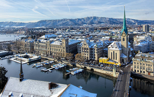 Zurich in winter Zurich, Switzerland - 18 January 2016: view on the city from the tower of the Grossmunster Cathedral towards Mt. Uetliberg. Zurich is the largest city in Switzerland and the capital of the Swiss canton of Zurich. fraumunster stock pictures, royalty-free photos & images