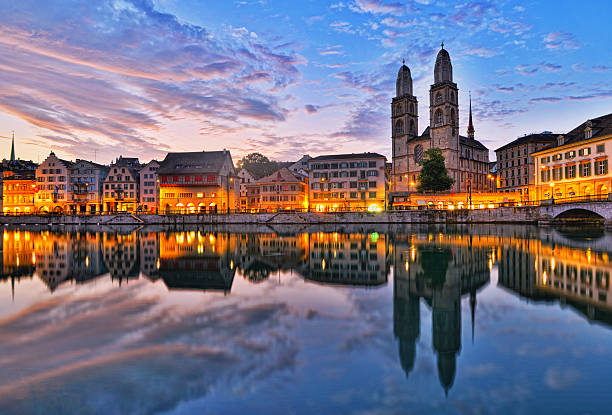 Zurich - Limmatquai and Grossmünster at sunrise View on the river Limmat, the old town Limmatquai and the landmark Grossmünster (Great Minister) church in Zürich, Switzerland, at sunrise zurich stock pictures, royalty-free photos & images