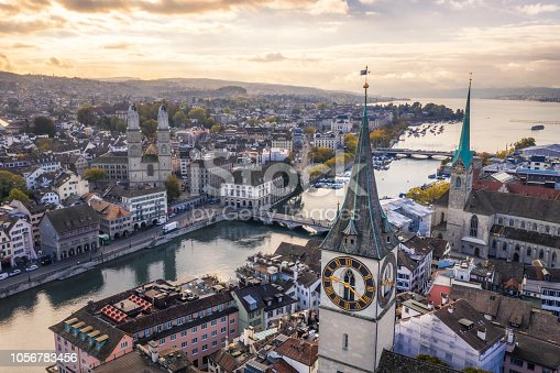 aerial view of St. Peter's Church clock tower, Fraumunster and Grossmunster by the Limmat River, Zurich old town at morning