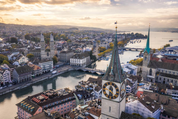 Zurich old town aerial view aerial view of St. Peter's Church clock tower, Fraumunster and Grossmunster by the Limmat River, Zurich old town at morning zurich stock pictures, royalty-free photos & images