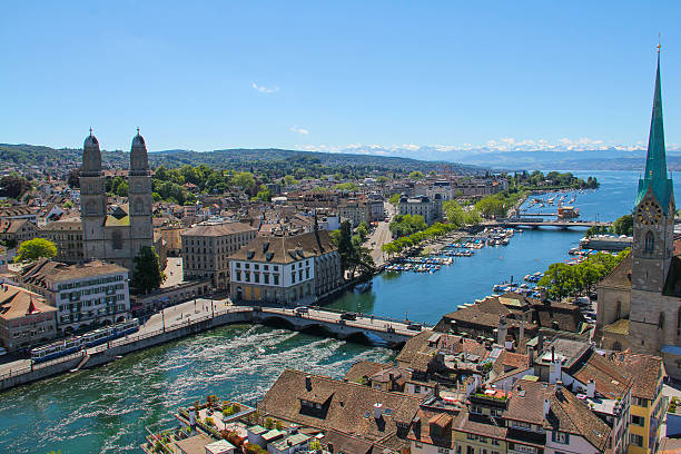 Zurich A view of the city centre of Zurich and the surrounding mountains.  zurich stock pictures, royalty-free photos & images
