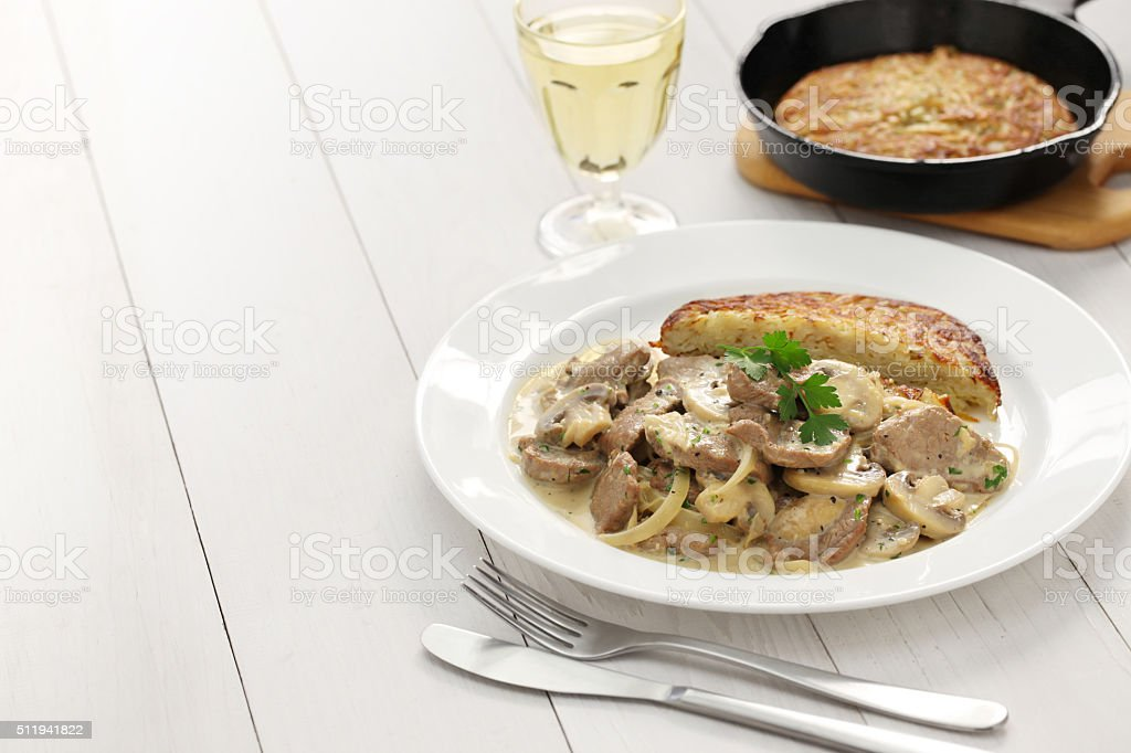 Zurich style veal stew and rosti potato stock photo