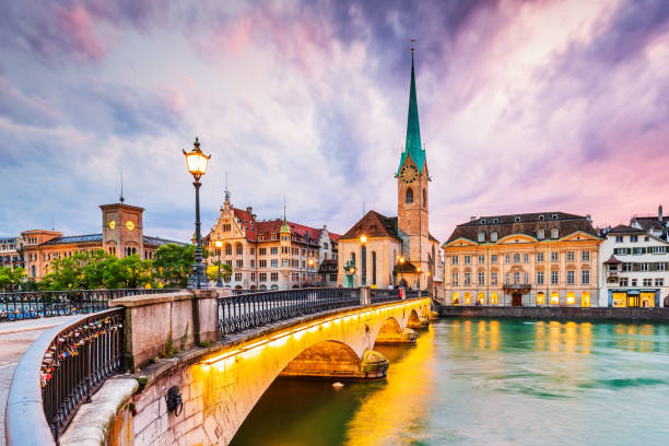 Zurich, Switzerland. Zurich, Switzerland. View of the historic city center with famous Fraumunster Church, on the Limmat river. zurich stock pictures, royalty-free photos & images