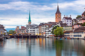 View of the city embankment and the clock tower at sunset. Zurich. Switzerland.