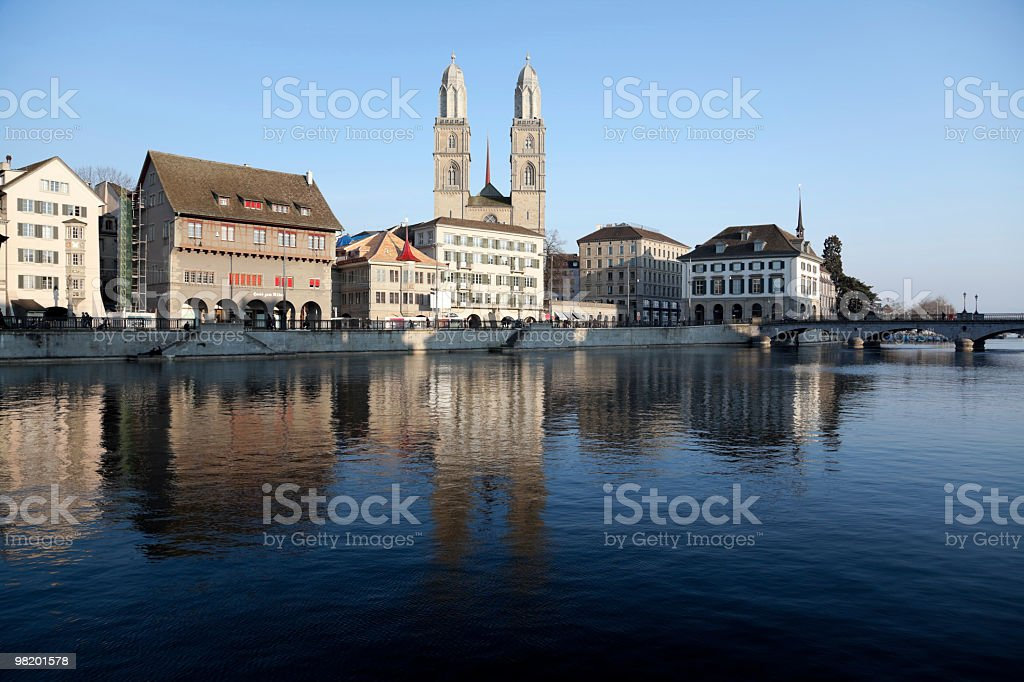 Zurichs Grossmünster with historical Skyline seen from River Limmat royalty-free stock photo