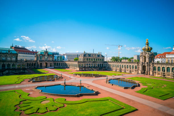 Zwinger Palace in Dresden, Germany, Europe Dresden, Germany - July 3, 2016: Dresden  view showing Zwinger Palace , trees and grasses can be seen on the background zwanger stock pictures, royalty-free photos & images
