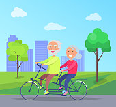 Happy mature couple riding together on bike on background of skyscrapers in city park vector illustration. Husband and wife on retirement