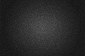 Rich black grained background with round gradient. Dotted textured vector backdrop for web and print design.
