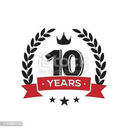 istock 10th birthday vintage label template. Tenth years anniversary retro isolated vector emblem with red ribbon and laurel wreath on white background. 1144597703