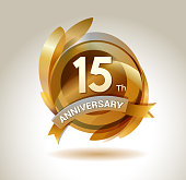 15th anniversary ribbon logo with golden circle and graphic elements