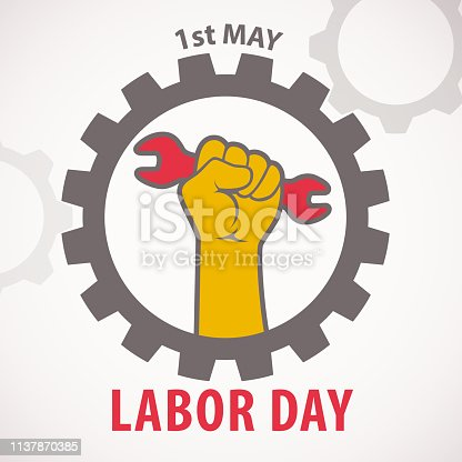 Celebrating the International Labor Day in 1st May with hand holding wrench inside the wheel showing the right of labor