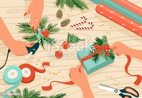 istock 2008.m30.i320.n005.S.c15.1488092072 Christmas present. Cartoon hands preparing for New Year celebration, signing invitation letters and packing colorful presents. Vector top view scene_f 1278669909
