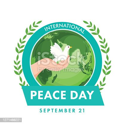 21st September, International Peace Day Concept with Human Hand Holding Dove, Olive Leaves and Earth Globe on White Background.