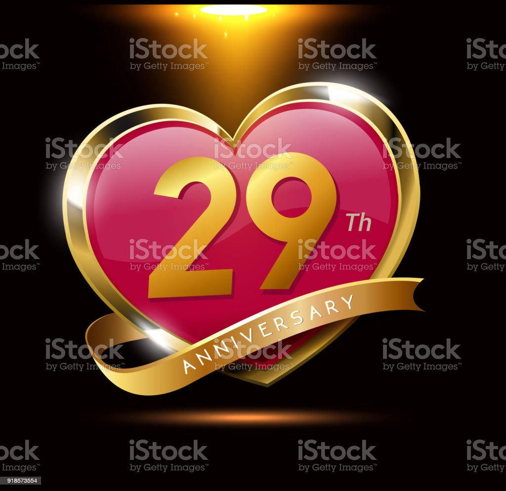 29th love anniversary with shiny gold on black background. heart shape with ribbon vector art illustration