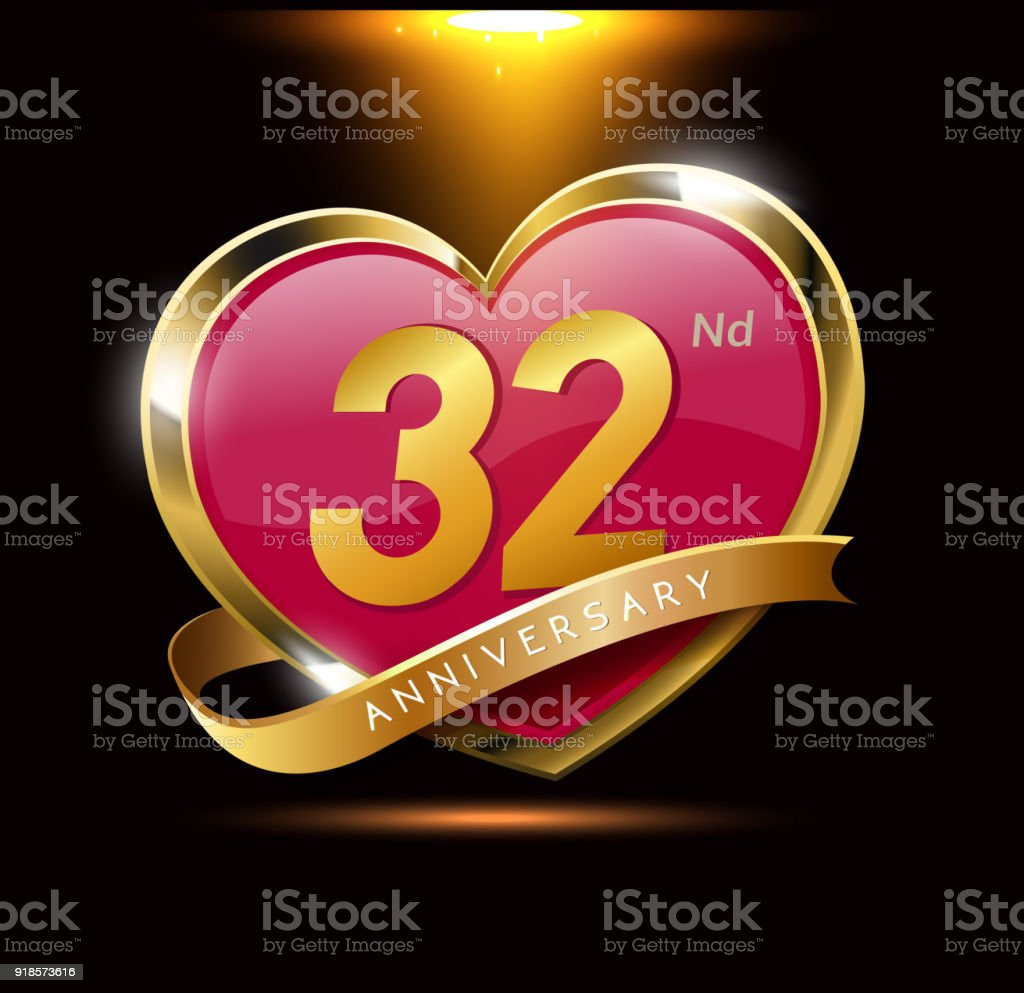 32nd love anniversary with shiny gold on black background. heart shape with ribbon vector art illustration