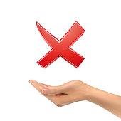 3d hand holding red cross mark over white background