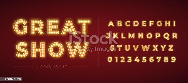 istock 3d light bulb alphabet with gold frame isolated on dark red background. 1178575269