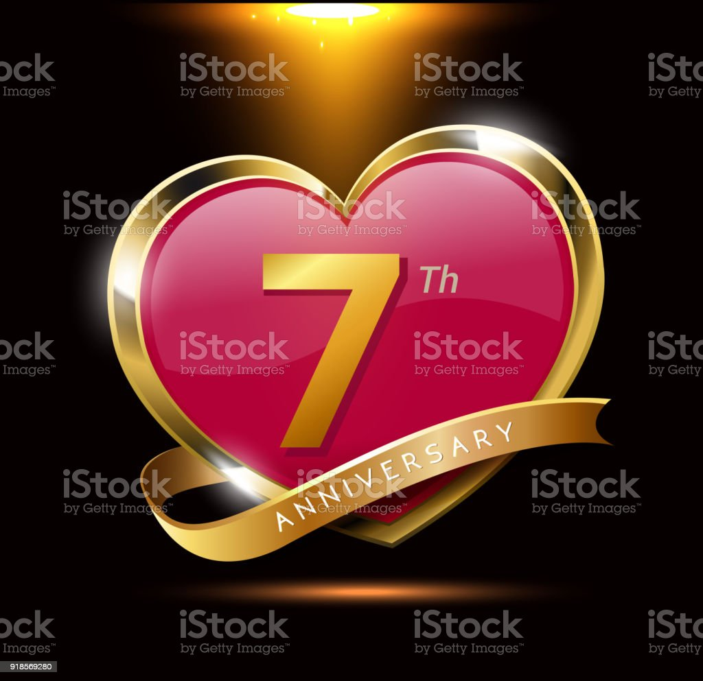 7th love anniversary with shiny gold on black background. heart shape with ribbon vector art illustration