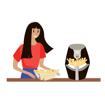 a girl in a red T-shirt cooks French fries in an air fryer and puts them in a transparent glass bowl on the table. Home appliances for making fast food.