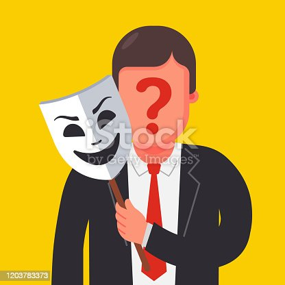 istock a person hides his identity under a mask. mysterious man 1203783373
